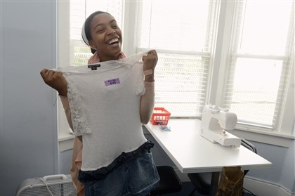 Maker's Place Oasis Project Micah Hudgins-Lopez, 13, of Highland Park shows off an outfit she made as part of the Maker's Place of the Oasis Project, which is run by the Bible Center Church in Homewood.