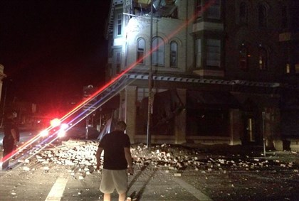 California Earthquake2 Residents look over damage to a building in Napa, Calif. early today. Officials say a 6.0-magnitude earthquake struck California's northern San Francisco Bay area.