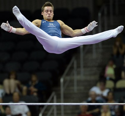 20140824mfgymsports13-12 Sam Mikulak competes on the high bar during the senior men's final of the P&G Gymnastics Championships at Consol Energy Center this afternoon.