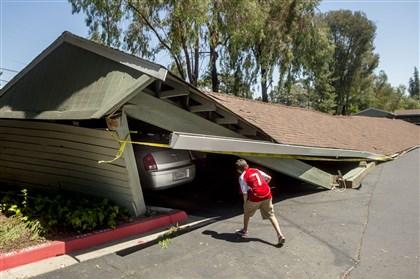 California Earthquake A boy examines cars trapped beneath a collapsed carport in Napa, Calif., following an earthquake this morning in the San Francisco Bay Area.