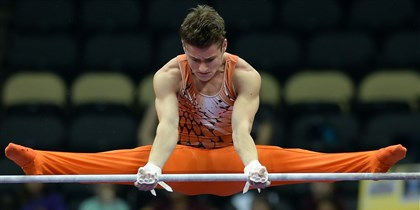 20140824mfgymsports12-11 Bobby Baker competes on the high bar during the senior men's final of the P&G Gymnastics Championships at Consol Energy Center today.