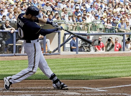Pirates Brewers Baseball Milwaukee Brewers' Jonathan Lucroy hits an RBI-single during the second inning of a baseball game against the Pittsburgh Pirates this afternoon in Milwaukee.