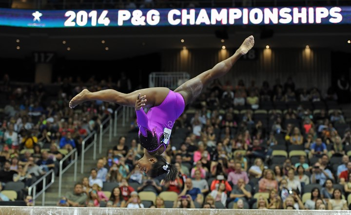 20140823mfgymsports02-1 Simone Biles performs on the high beam in the senior women's portion of the P&G Gymnastics Championships at Consol Energy Center Saturday night.