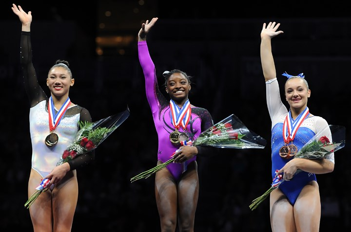 20140823mfgymsports06-5 Simone Biles, center, takes first place at the senior women portion of the P&G Gymnastics Championships at Consol Energy Center Saturday night. On her left is Kayla Ross, second place, and on her right, is Maggie Nichols, third place.