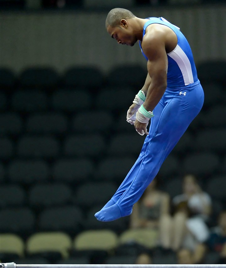 20140824mfgymsports11-10 John Orozco competes on the high bar during the senior men's final of the P&G Gymnastics Championships today, the last day of the four-day event.