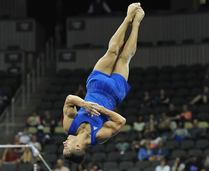 20140824mfgymsports09-8 Jacob Dalton performs his floor exercise during the senior men's final of the P&G Gymnastics Championships.