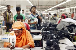 Garment workers at the Nishat Complex, a Ha-Meem Group factory, sew pockets for blue jeans in early July.
