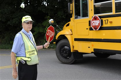 Bethel Park High crossing guard Milton Deithorn, a crossing guard at Bethel Park High School, directs traffic at the intersection of Church Road and Blackhawk Drive.