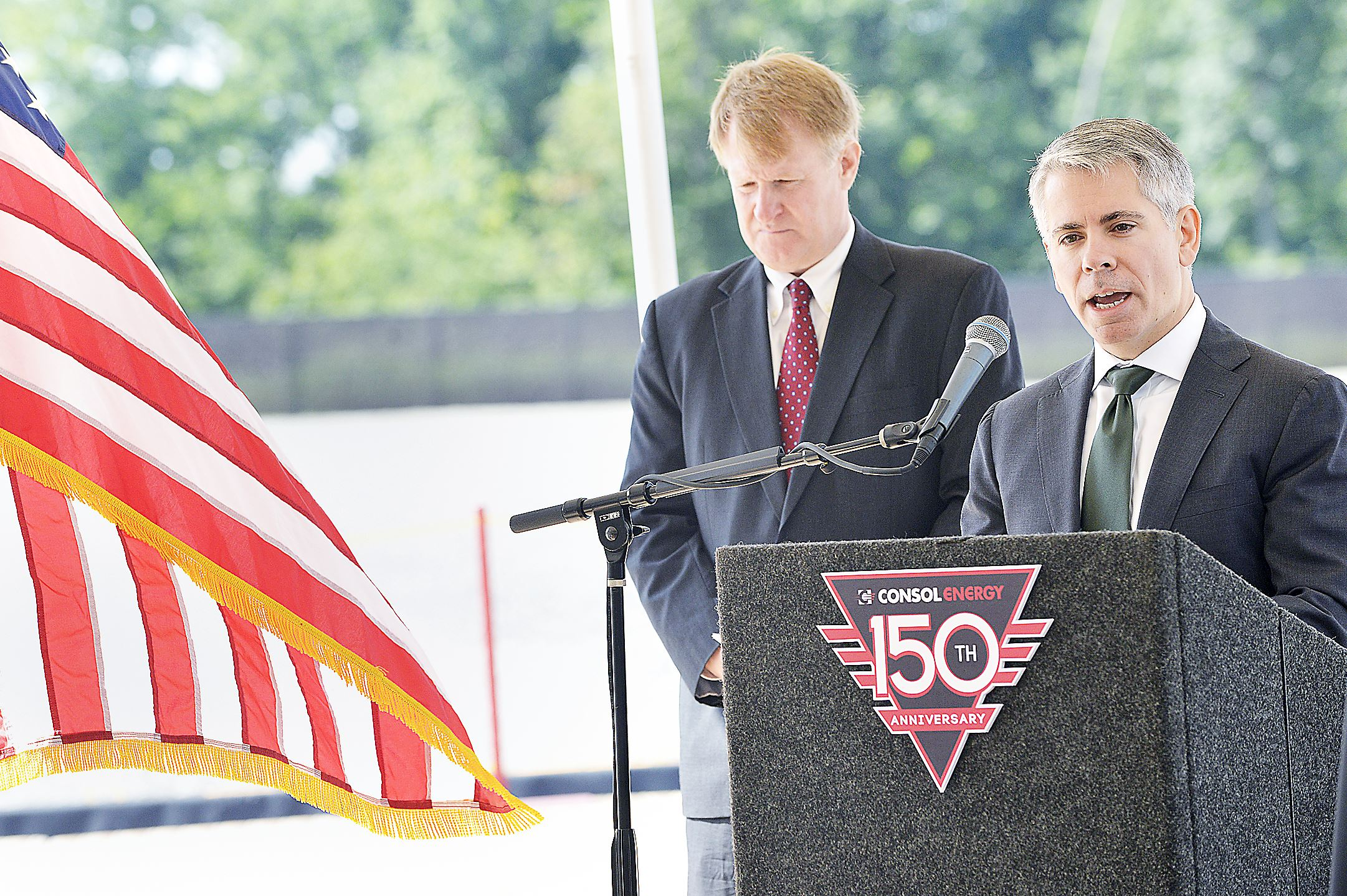 Nick Deluliis, right, CEO of Consol Energy Nick Deluliis, right, CEO of Consol Energy, talks about the process of developing the new Marcellus Shale well site near Pittsburgh International Airport. At left is Allegheny County Chief Executive Rich Fitzgerald.