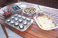 Arlene Burnett's Labor Day desserts include Peach-and-Nectarine Cobbler, Blueberry- Cormeal Cake, Chocolate-Cherry Cookie Dough-filled Cupcakes and South African Mud Cake.
