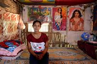 Kamala Biswa, 19, sits in her neighbor's home in Bildangi II, one of the remaining Bhutanese refugee camps in eastern Nepal, near the Indian border. Kamala, a shy girl, is immigrating to Akron, Ohio.