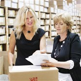 Marcia Cubitt, president, Essential Bodywear, left, and CEO Carrie Charlick talk in their warehouse in Commerce Township, Mich. Ms. Charlick and  Ms. Cubitt have $4 million in sales but have been rejected for $500,000 credit lines since 2012.