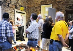 Ranger Brian Reedy, chief of interpretation, leads visitors on a basement to attic tour of the Gallatin house in Fayette County.