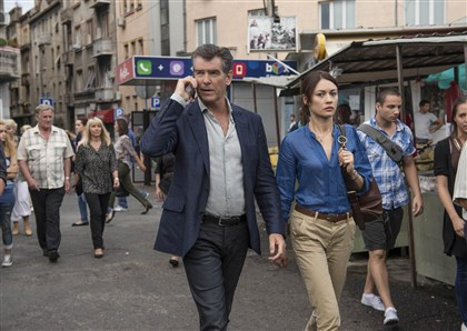 "NovemberMan3-1 Pierce Brosnan and Olga Kurylenko star in ""The November Man."""