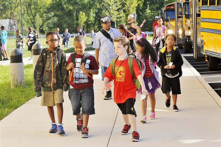 Penn Hills Elementary Center Children arrive on buses for classes at Penn Hills Elementary Center.