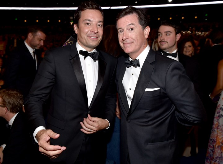 66th Primetime Emmy Awards - Audience Jimmy Fallon, left, and Stephen Colbert pose at the 66th Primetime Emmy Awards.