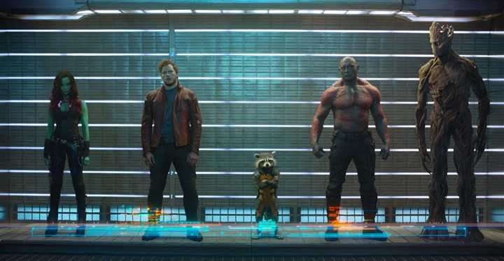 summermovie01 Marvel's Guardians Of The Galaxy stars, from left, Zoe Saldana, Chris Pratt, Rocket Raccoon (voiced by Bradley Cooper), Dave Bautista and Groot (voiced by Vin Diesel).
