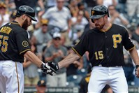 Ike Davis is congratulated by Russell Martin after hitting a two-run home run against the Cardinals in the second inning today at PNC Park.