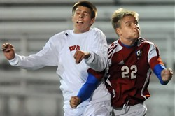 West Allegheny's Collin Wurst, left, battles against Mount Pleasant's Tyler Kolar during a playoff match last season.