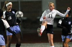 Hopewell's Abby Losco, right, drives the ball past Central Valley's Ashley Mutkus during a match last season.