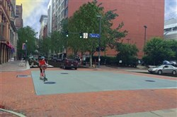 A rendering of the bike lane on Penn Avenue in the Cultural District, Downtown.