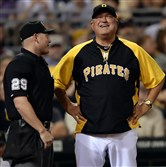 Pirates manager Clint Hurdle talks with home plate umpire Sean Barber during an August game against the Cardinals.