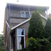 The exterior of 522 Wilson Ave., in Ambridge, a split-level house for sale.