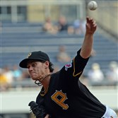 Jeff Locke pitches against the Cardinals Wednesday afternoon at PNC Park.