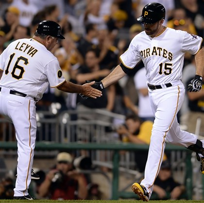The Pirates' Ike Davis is congratulated by third base coach Nick Leyva after hitting a three-run home run against the Cardinals in the eighth inning at PNC Park.
