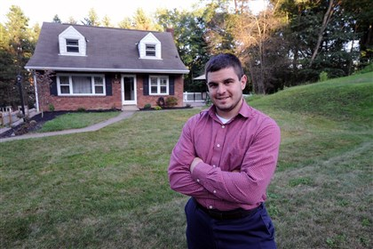 20140826JHBIZGanley Steve Ganley, 25, at the home he bought in Bethel Park with a $150,000 mortgage he qualified for.