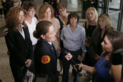 Gay Marriage  Ruth Morrison, center, a retired Indianapolis Fire Department battalion chief, talks to a reporter after attending a hearing before the 7th U.S. Circuit Court of Appeals on the challenges to Indiana and Wisconsin's gay marriage ban Tuesday, Aug. 26, 2014, in Chicago. Morrison worries that because Indiana won't recognize the woman she married in another state as her wife, she wouldn't be able to pass on pension and other benefits if she dies. (AP Photo/Charles Rex Arbogast)