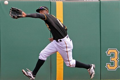 20140827mfbucssports05-1 Starling Marte pulls in a fly ball hit by Cardinals' Jon Jay in the fourth inning Wednesday afternoon at PNC Park.
