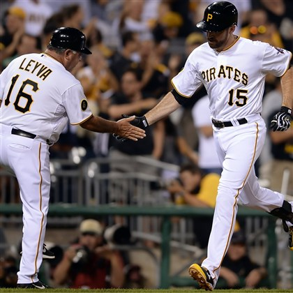 20140826mfbucssports10-2 The Pirates' Ike Davis is congratulated by third base coach Nick Leyva after hitting a three-run home run against the Cardinals in the eighth inning at PNC Park.