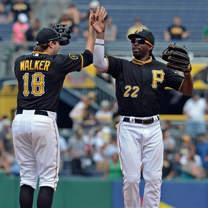 20140827mfbucssports08 Neil Walker and Andrew McCutchen celebrate the win over the Cardinals at PNC Park.