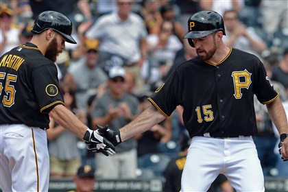 Ike Davis Russell Martin Ike Davis is congratulated by Russell Martin after hitting a two-run home run against the Cardinals in the second inning today at PNC Park.