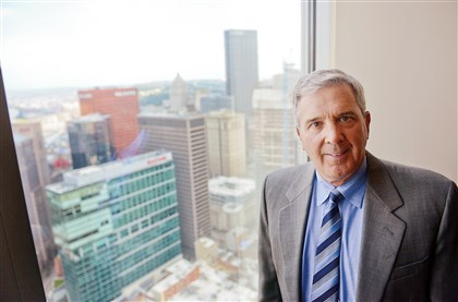 20140827MWHbrunchBiz01 PPG chairman Charles Bunch on the 40th floor of One PPG Place.