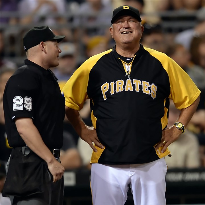 20140826mfbucssports03 Pirates manager Clint Hurdle talks with home plate umpire Sean Barber after the Cardinals' A.J. Pierzynski was awarded first base on a hit by pitch in the fifth inning at PNC Park.