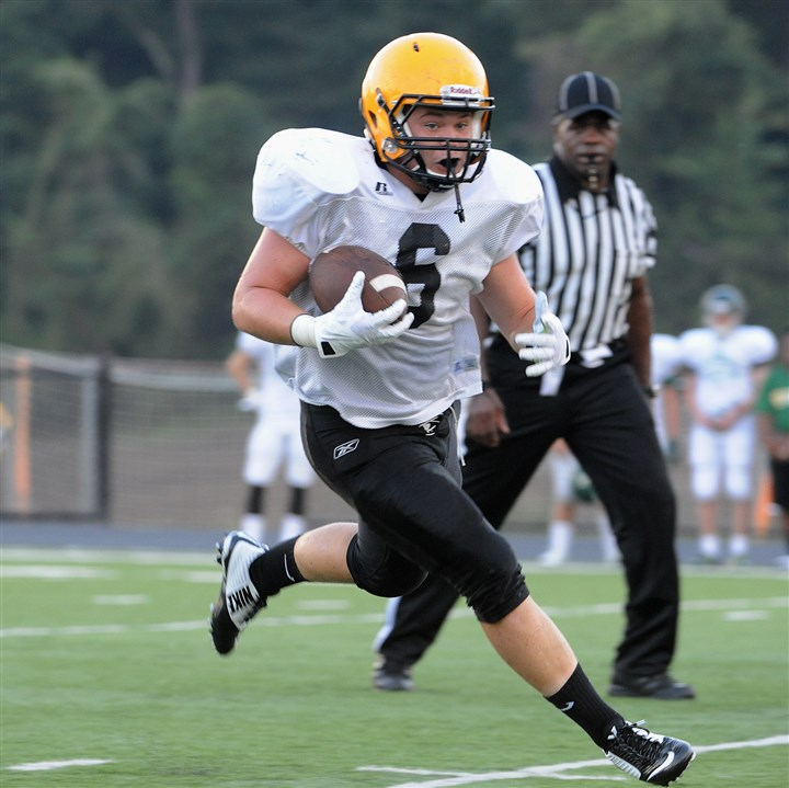 SPO Montour's Zachary McGown breaks into the open field to pick up yardage during a [preseason scrimmage against Seton-LaSalle last Friday at Montour.