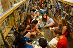 Third-graders read books after a tour at the library during the first day of school at Highcliff Elementary School in Ross. Instead of two larger and five smaller elementary schools, North Hills School District has four comparably sized, renovated elementary schools where the district can offer similar academic opportunities, better balance class sizes and have room for full-day kindergarten as well as separate spaces for art, music and library.