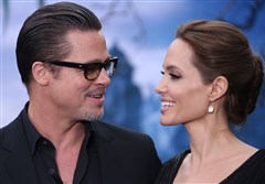 "Brad Pitt and Angelina Jolie shown at the ""Maleficent"" exhibition in London on May 8.  The couple were wed last Saturday."
