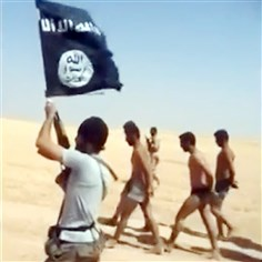 islamicState65-1 An image grab taken from a video uploaded on Thursday shows young men in underwear being marched barefoot along a desert road before being allegedly executed Wednesday by Islamic State militants at an undisclosed location in Syria's Raqa Province.