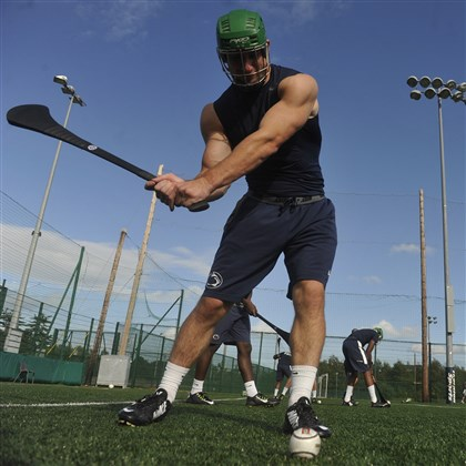 psu0829c-2 Penn State's Mike Hull and other members of the NCAA college football team receive lessons in hurling and Gaelic football at University College in Dublin, Ireland Thursday.