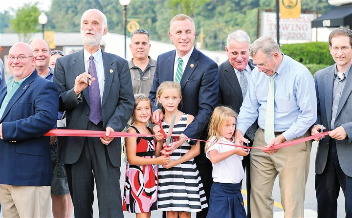 20140827JHWestRibbon Heidelberg Mayor Ken LaSota, second from left, orchestrates the ribbon cutting on Route 50 in Heidelberg, signaling the completion of the Tri-Community Revitalization Project. Also attending the Aug. 27 ceremony were U.S. Rep. Tim Murphy, R-Upper St. Clair, center, Allegheny County Councilman Mike Finnerty, second from right, and Carnegie Mayor Jack Kobistek, right.