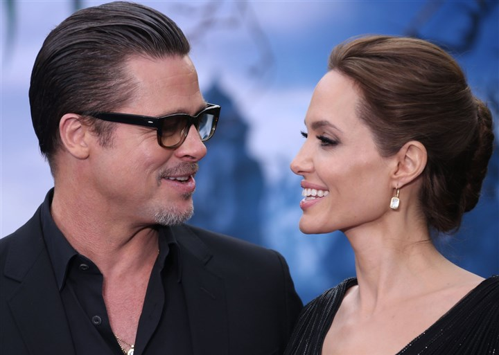 "pittJolie Brad Pitt and Angelina Jolie shown at the ""Maleficent"" exhibition in London on May 8. The couple were wed last Saturday."