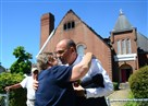 Pittsburgh City Council president Bruce Kraus comforts Rev. Sue Hutchins of Hilltop United Methodist Church in Allentown after a three-alarm fire ripped through the roof of the church the day before.