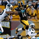 Markus Wheaton leaps for a small gain against the Panthers in the first half Thursday at Heinz Field.