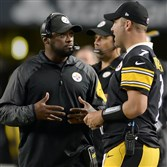 Steelers head coach Mike Tomlin talks with quarterback Ben Roethlisberger on the sideline during the final preseason game against Carolina.