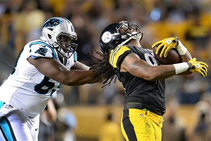 20140828pdSteelersSports02 Carolina Panthers' Fernando Velasco pulls down linebacker Jarvis Jones during Thursday night's game at Heinz Field.