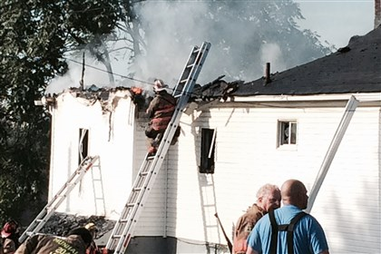 West Mifflin fire Firefighters work to extinguish a fire at 1032 McClure Avenue in West Mifflin on Friday morning.