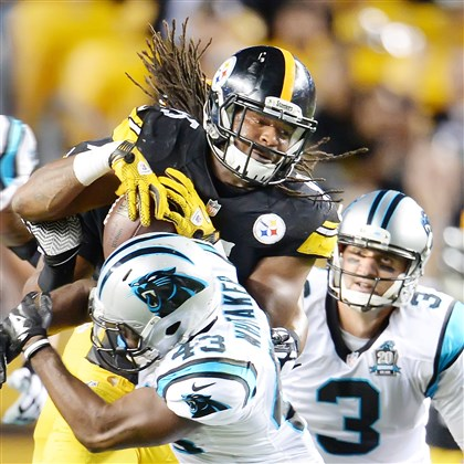 20140828pdSteelersSports05-1 Steelers linebacker Jarvis Jones recovers fumble against Carolina during a preseason game Thursday at Heinz Field.